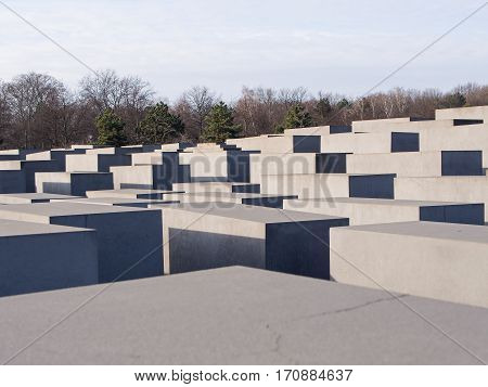 BERLIN GERMANY - JANUARY 29 2017: The Memorial to the Murdered Jews of Europe With Tiergarten Park In Background Berlin
