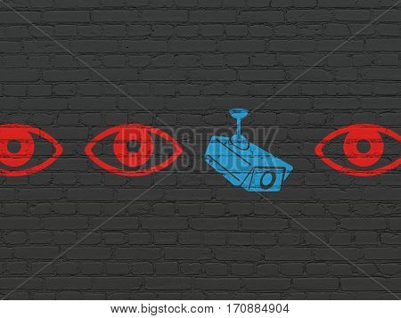Protection concept: row of Painted red eye icons around blue cctv camera icon on Black Brick wall background