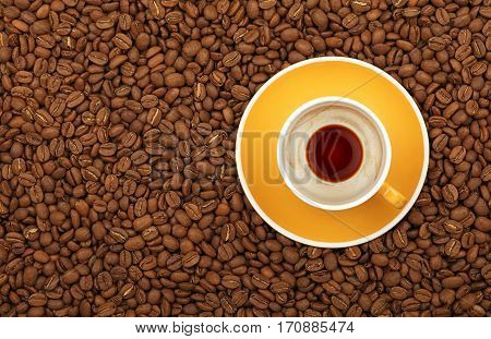 Empty Black Coffee Yellow Cup And Saucer On Beans