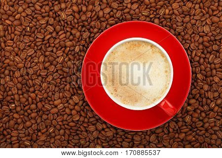 Full Latte In Red Cup With Saucer On Coffee Beans