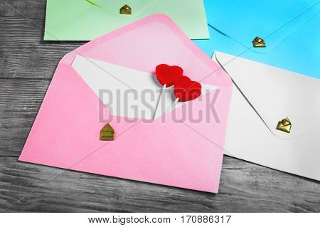 Valentines Day Envelope Mail Red Heart. Valentine Letter Card Wedding Love Concept in colorful letters envelopes. Gold seal with hearts valentine envelopes. Vintage white wood background.