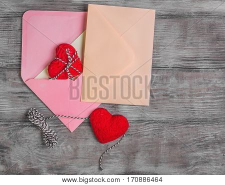 Card to Valentine's Day. Paper for text congratulations letter. Heart from red marzipan. Heart with pattern and heart sleek white wooden background. Top view. Blank space.