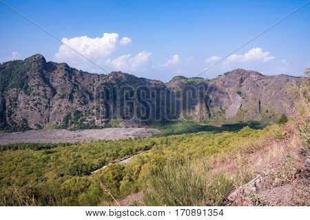 Mount Somma is the remnant of a large volcano out of which the peak cone of Mount Vesuvius has grown.