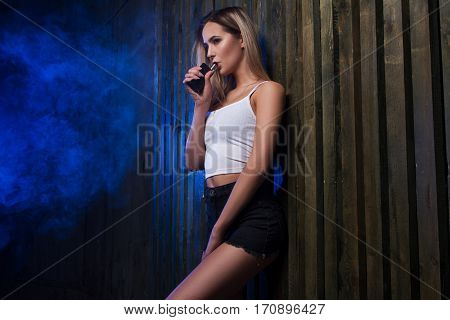 Girl Smoke Vape. Smoking And Vaping. Young Smoker Woman With Electronic Cigarette Gadget.