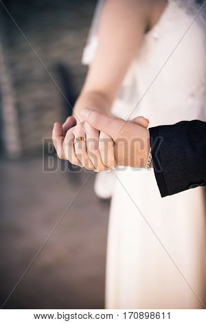 Newlyweds dancing. Bridegroom Holds the Hand of the Bride