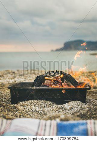 Mangal with burning coal at the sea coast, Alanya, Antalya, Mediterranean Turkey. Picnic or outdoor gathreing concept
