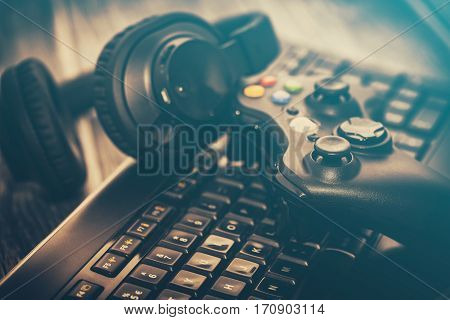 fun gamepad video console gaming game play gamer player headset earphones keyboard concept - stock image