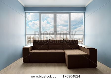 Clean Family Room With Brown Couch