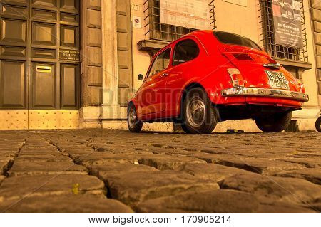ROME, ITALY - MAY 10, 2016: Old red Fiat 500 on streets of Rome