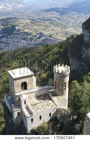 The Tower of Erice (Torretta Pepoli), in the town of Erice, Sicily, Italy overlooking the mountains, woods and town below