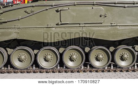 Steel Military tank, detail of tracks or wheels of the off-road armored vehicle