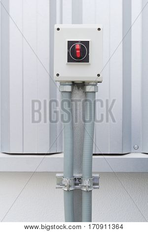 Industrial switch control button for electrical control outside factory building.