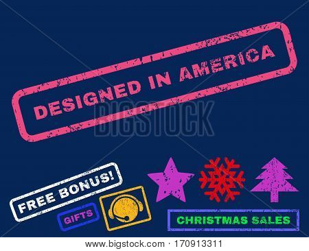 Designed In America text rubber seal stamp watermark with bonus new year symbols. Caption inside rectangular shape with grunge design and unclean texture.
