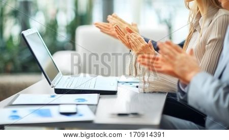 Close-up of business people clapping hands. Business seminar con