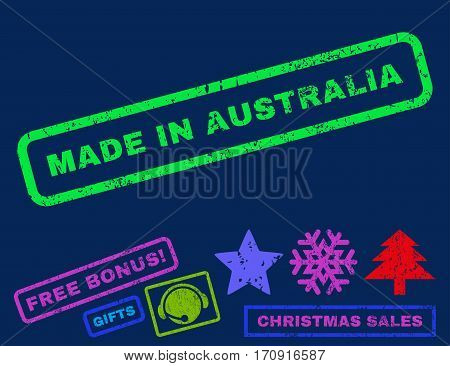 Made In Australia text rubber seal stamp watermark with additional bonus christmas symbols. Tag inside rectangular shape with grunge design and dust texture.