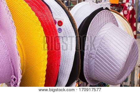 Collection Of Colorful Hats On Stall At The Bazaar
