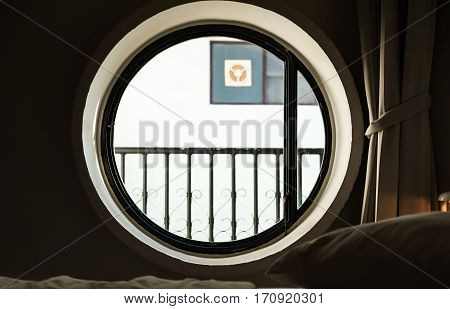 Round circle window with bright light in the morning