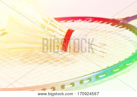 Close up shuttlecock on badminton rackets with color filters