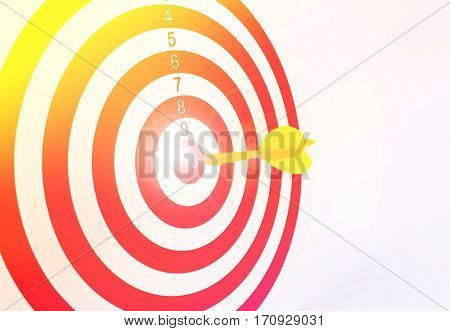 Colorful darts at a target. Red dart hit the aim.