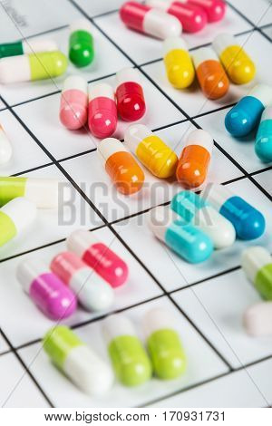 different color tablets and pills on a calendar medication.