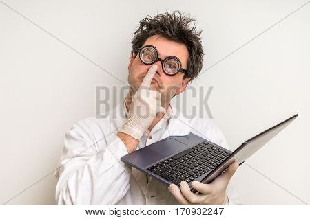 Crazy Scientist With Laptop Working In His Laboratory