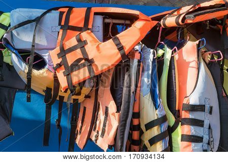 Life jacket Hanging on the wall beside the sea.