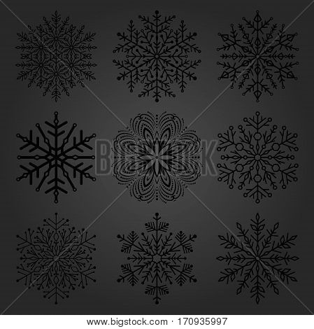 Set of dark snowflakes. Fine winter ornament. Snowflake collection