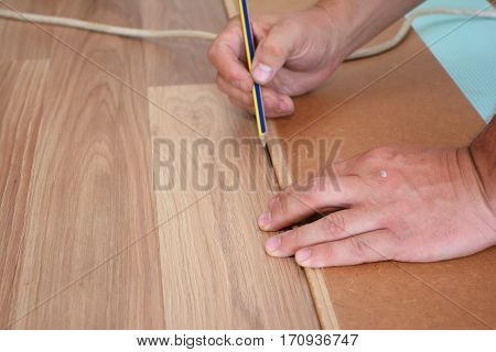 Man laying laminate flooring. Man laying laminate flooring. Step by Step.