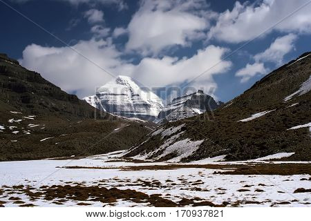 View to the South Face of sacred Mount Kailash in Western Tibet on a cloudy spring day.