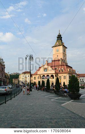 Brasov, Transylvania, Romania - September 22 2016 : Tourist walk along side the History Museum in Brasov circa 2016