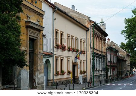 Brasov, Transylvania, Romania - September 22 2016 : Old and new buildings on street in Brasov Romania circa 2016
