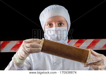 Horizontal Portrait Of Biologist Investigating Contaminated Sites On A Black Background