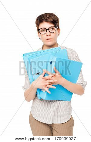 Portrait Of A Bewildered Woman With A Folder In Hands On A White Background