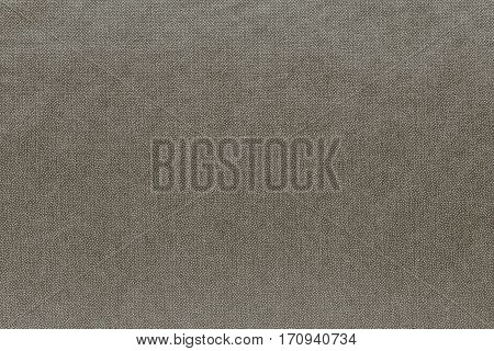 abstract background and speckled or mottled texture of fabric or textile material of pale khaki color