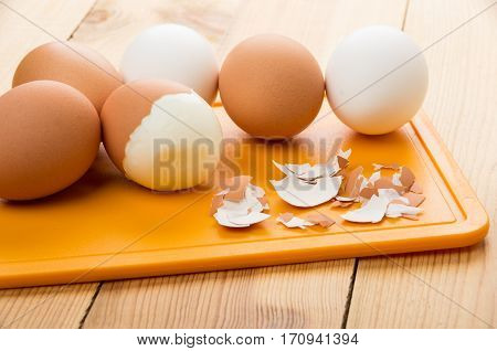 Boiled Brown And White Eggs, Eggshell On Chopping Board