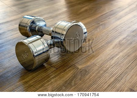 A Pair Of Dumbells In A Sport Fitness Room