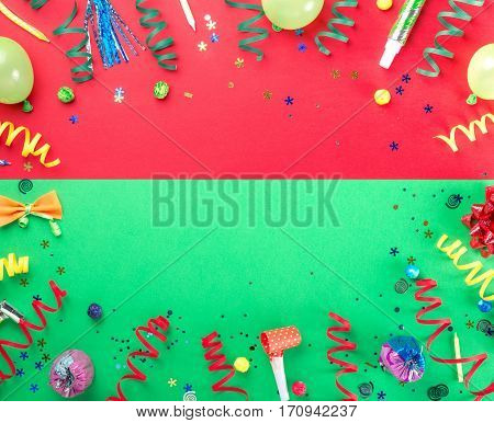 Frame from various celebratory items on colorful background top view