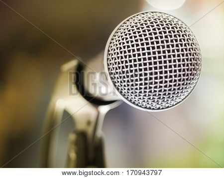 Close up of microphone in karaoke room or conference room. With place your text on background