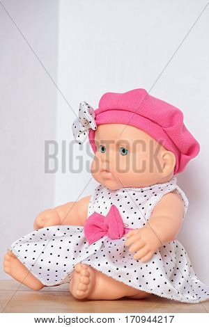 the doll with pink bow close to
