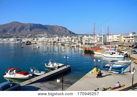 HERSONISSOS, CRETE - SEPTEMBER 17, 2016 - Boats and ships moored in the harbour with views towards the town and mountains Hersonissos Crete Greece Europe, September 17, 2016.