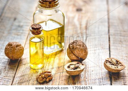 cosmetic and therapeutic walnut oil on wooden background.