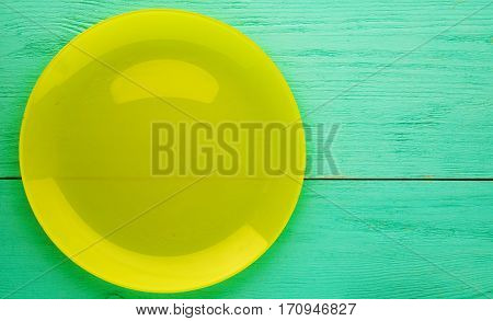 Plate On A Wooden Background. Plate Top View. Yellow  Plate .copy Space