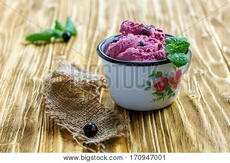 Homemade Ice Cream Of Black Currant In An Enamel Mug.