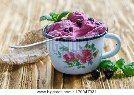 Berry Ice Cream With Black Currant In An Enamel Bowl.