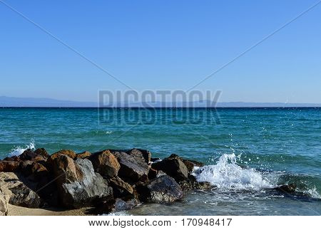Waves breaking on the rocks. Kassandra Halkidiki Greece