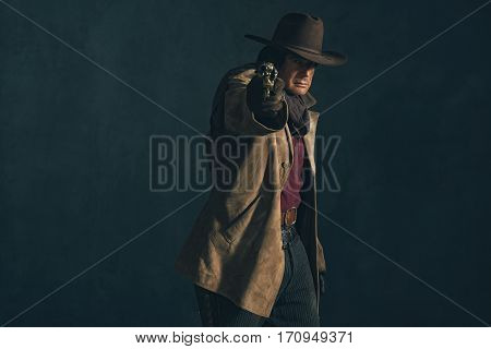 Retro Late 1960S Western Actor. Shooting With Revolver.