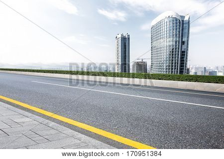 modern office buildings in hangzhou new city from empty road