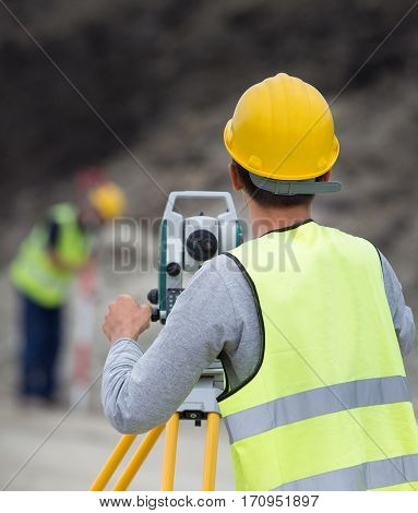 Civil Engineers With Theodolite