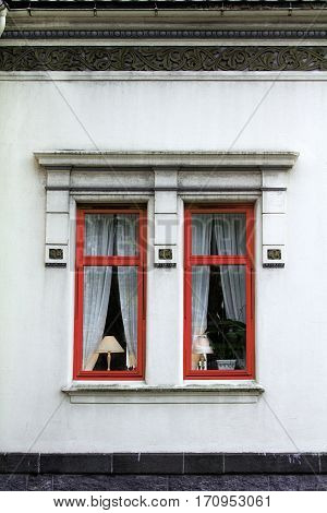 lampshade lit window exterior red house home