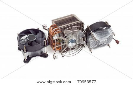 Active CPU cooler with large finned heatsink fan copper heat pipes and thermal pad two coolers with aluminum finned heatsinks and fans on a light background